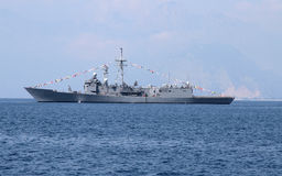 Warship. A grey navy warship anchored at sea stock photography