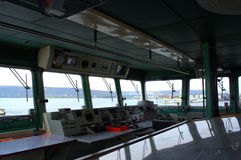 Warship bridge inside. Warship bridge view from inside- elevated, enclosed platform on a ship from which the captain and officers direct operations Stock Image