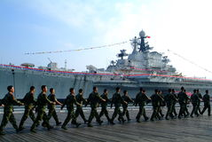 Warship and chinese soldier. Warship in the bay and Soldier training Royalty Free Stock Photos