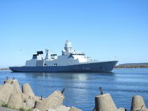 Warship coming in Klaipeda town, Lithuania Royalty Free Stock Image