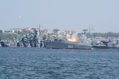 Warship firing a rocket launcher in the Sevastopol bay. Demonstration of naval equipment to Russian Navy Day royalty free stock photography