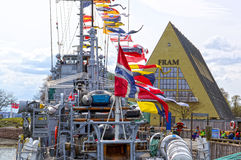 Warship with flags in front of Fram museum. Oslo, Norway, May 08, 2013 Royalty Free Stock Photography