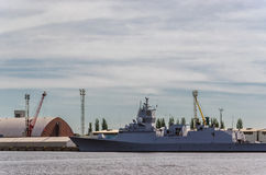WARSHIP. A frigate at a civil port quay Royalty Free Stock Photos