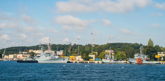 Warship in a harbor Stock Image
