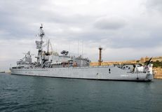 Warship heading out of Maltese Harbour Royalty Free Stock Photo