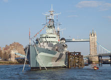 HMS Belfast and Tower Bridge, London. Warship HMS Belfast which is now used as a museum on the River Thames with the landmark of Tower Bridge in the background Royalty Free Stock Photo