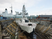Warship M33 in drydock with HMS dauntless in the background royalty free stock image
