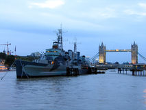 Warship near Tower Bridge in London Royalty Free Stock Photography