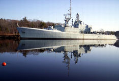 Warship reflection,The H M C S Fraser. Warship reflection, old derelict warship The H M C S Fraser tied to wharf lahave river Bridgewater Lunenburg County Nova royalty free stock photo