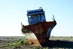 Warship remains. Rusty remains of a warship on the bottom of the dried-up Aral Sea Royalty Free Stock Images