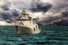 Warship on sea. Of dramatic scenery stock photos