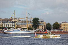 Warships and combat aircraft parade on the Neva river. Day of the Russian Navy. Stock Photography