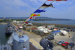 Warships docked Stock Images