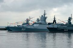 Warships at the pier. KRONSTADT, SAINT PETERSBURG, RUSSIA - AUGUST 21, 2017: warships docked in Peter the great middle harbour Stock Photography