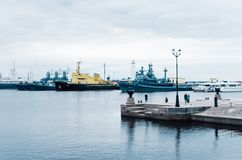 Warships stand in the bay. Russia, Kronstadt. royalty free stock photo