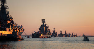 Warships in the wake ranks. At sunset Royalty Free Stock Images