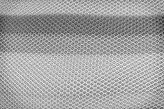 Warstwa tekstura, biel, szarość i czerń siatki honeycomb tkaniny, deseniuje tło fotografia stock
