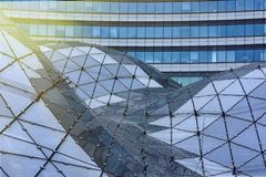 Warszaw, Poland, October 18, 2018: the glass roof of the shopping centre on the background of office building stock photography