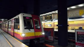 Warszaw Underground Train Stops at a Platform. And passengers embark and disembark stock video