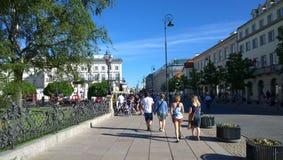 Warszawa. Pedestrians walking in Krakowskie Przedmieście in central Warszawa Royalty Free Stock Photos