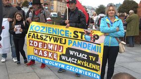Warsaw, Poland 10.10.2020 - Anticovid freedom march - banner sign carried by crowd
