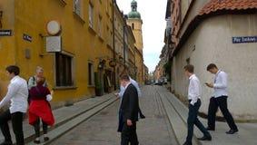 Warszawa. Youth walking in Old Town of Warszawa Royalty Free Stock Photos