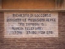 Wartime sign in Bologna. BOLOGNA, ITALY - CIRCA SEPTEMBER 2017: WW2 wartime sign, Richiesta di soccorso durante le incursioni aeree (meaning Rescue request royalty free stock photos