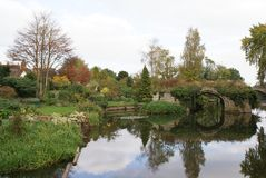 Warwick Castle garden at a lakeside in Warwick, England, Europe Royalty Free Stock Photography