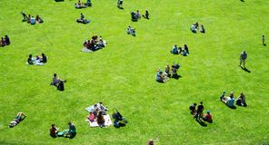 Warwick, Warwick Castle, UK, May 5, 2018. Groups Of People Having Picnic Sitting On Grass. Groups Of People chilling on grass royalty free stock photo
