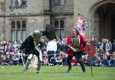 Warwick Castles Warriors - Mediaeval sword play Stock Photography