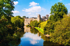 Warwick, UK. Castle of Warwick with river Stock Photography