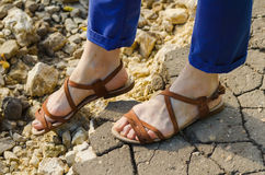 Wary step on a stony road. Closeup woman legs Royalty Free Stock Image
