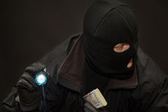 Wary thief with money in hand. Looking around Stock Image