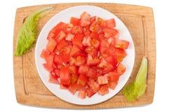 warzywa białe tło Pomidor, zielenie, tnąca deska, talerz na białym tle Fotografia Stock