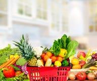Warzywa i owoc nad kuchennym tłem Fotografia Royalty Free