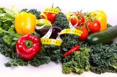 Warzywa i pomiarowa taśma, diety pojęcie Obrazy Stock