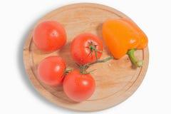 Warzywa jedzenie - pieprz i pomidor Zdjęcie Stock