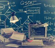 This was ages ago, computer lab on green chalkboard background. On old table stock image