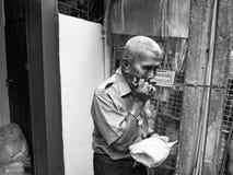 He was blowing a harmonica mouse,Wang Lang Market,Bangkok,Thailand royalty free stock image