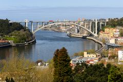 The Arrabida Bridge is one of the bridges that separates the Port of Vila Nova de Gaia. stock photo