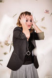 She was crying and flying around money. Stock Images