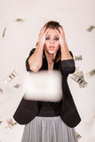 She was crying and flying around money. Stock Photos