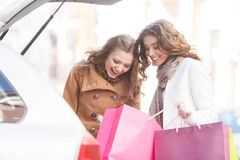 That was really good shopping. Two beautiful young women showing Stock Photography