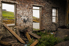 It was a house once, now it is a ruin standing on the Island of Uist in Scotland, Europe. An dilapidated house without doors and windows Stock Photos