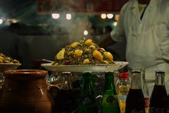 A plate of street food at Morocco Marrakesh. This was shot in Marrakesh the street food was shot at night on the streets of Marrakesh it has some olives and stock image