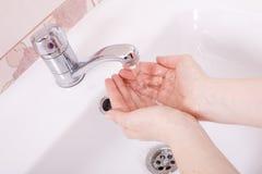 Was uw handen Stock Foto