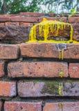 Was van de kaars op rode baksteen wordt gesmolten die Stock Afbeelding