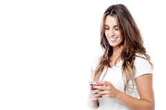It was an very funny message !. Cheerful woman messaging via her phone Stock Images