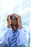 It was an very tedious work. Frustrated businessman sitting in office steps Stock Photos