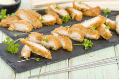 Wasabi Chicken. Battered and deep fried chicken fillets served with wasabi mayo Stock Photos